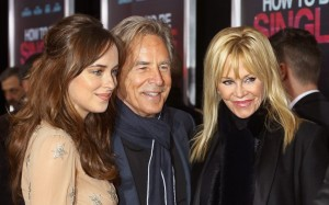 Dakota Johnson is supported by her famous parents Don Johnson and Melanie Griffith at the premiere of her film How to Be Single in New York City.