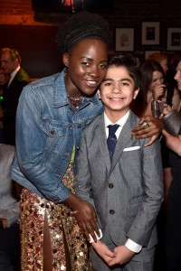 Lupita Nyong'o and Neel Sethi at the world premiere of The Jungle Book held at El Capitan Theatre, Hollywood Blvd, Los Angeles, California on April 4, 2016.
