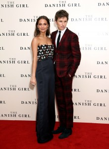 co-stars Alicia Vikander and Eddie Redmayne attend the U.K. film premiere of The Danish Girl held at Odoen cinema, Leicester Square, London on December 8, 2015.