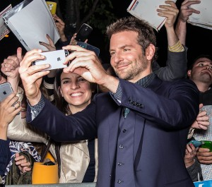 Bradley Cooper with fans at the New York film premiere of Burnt held at the Musuem of Modern Art, NYC on October 20, 2015.