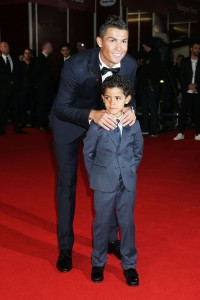 Cristiano Ronaldo and his son Cristiano Jr. at the world film premiere of Ronaldo held at Vue West End, Leicester Square, London on November 9, 2015.