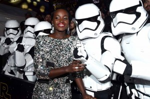 Lupita Nyong'o with Stormtroopers at the World Premiere of Star Wars: The Force Awakens held at TCL Chinese Theatre, Hollywood Blvd, Los Angeles, CA on December 14, 2015.