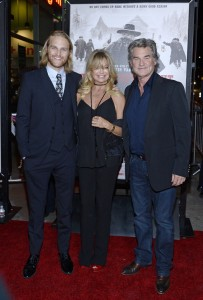 Goldie Hawn and Kurt Russell with their son Wyatt at the Los Angeles film premiere of The Hateful Eight held at ArcLight Cinemas, Sunset Blvd on December 7, 2015.