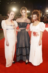 Lily James with zombies at the Pride and Prejudice and Zombies London premiere on February 1, 2016 at Vue West End, Leicester Square.