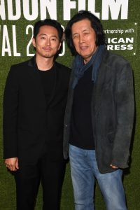 Steven Yeun and Lee Chang-Dong attend the UK premiere of Burning during 62nd BFI London Film Festival