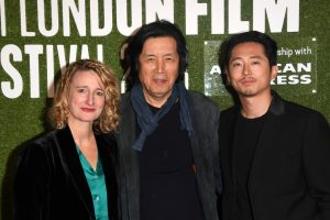 Tricia Tuttle, Lee Chang-Dong and Steven Yeun attend the UK premiere of Burning during 62nd BFI London Film Festival