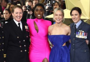 Lashana Lynch and Brie Larson with British Servicewomen attends the European premiere of Captain Marvel in London.
