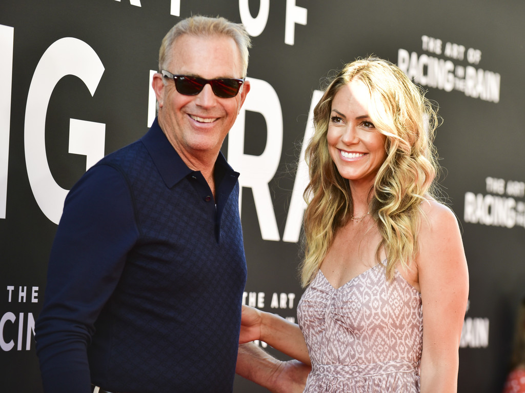 Kevin Costner and Christine Baumgartner The Art of Racing in the Rain Los Angeles Premiere Arrivals