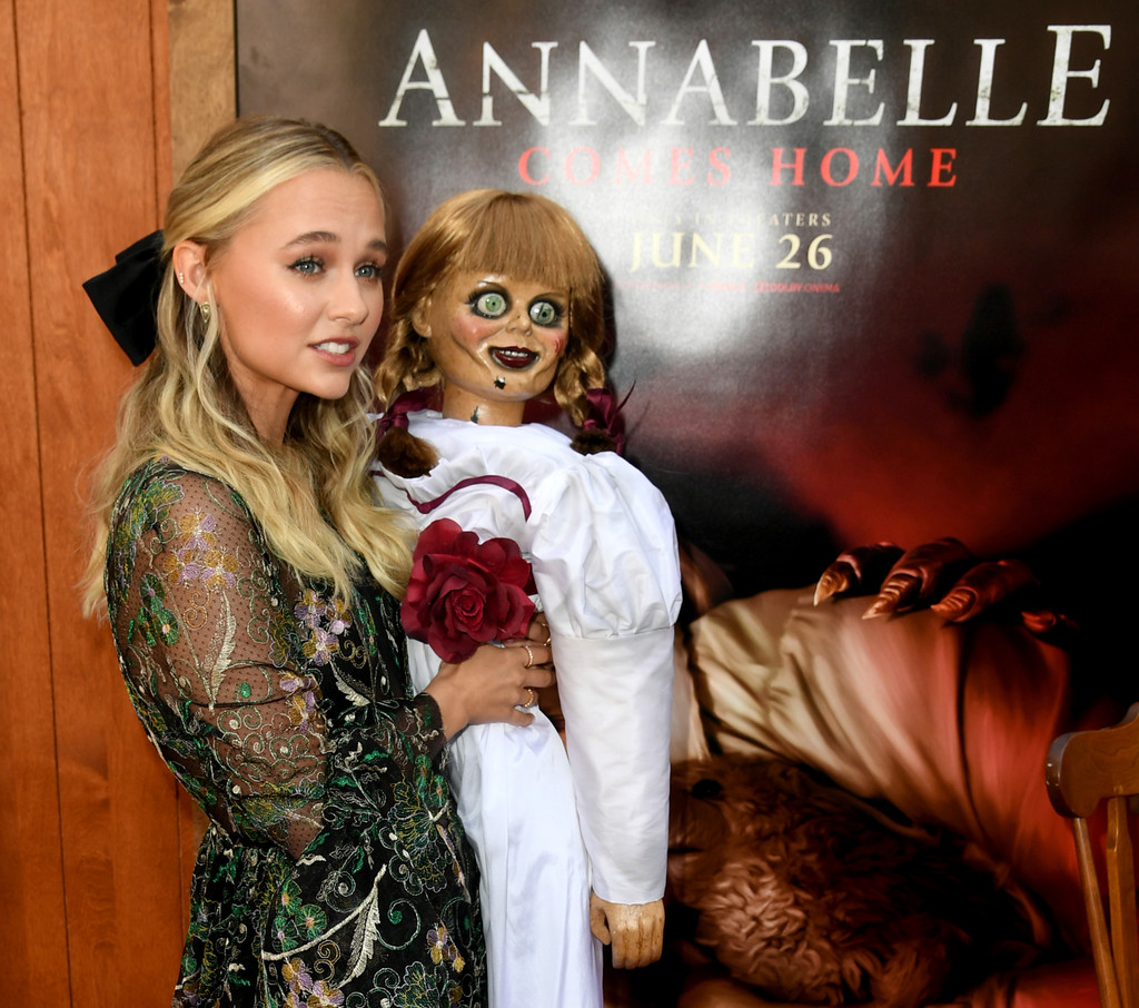 Madison Iseman holds Annabelle doll Annabelle Comes Home Los Angeles Premiere